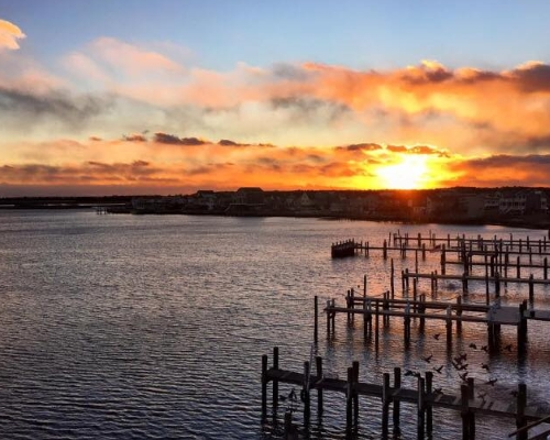 Image of a Sunset over the Ocean at Panini Bay Restaurant in Tuckerton NJ