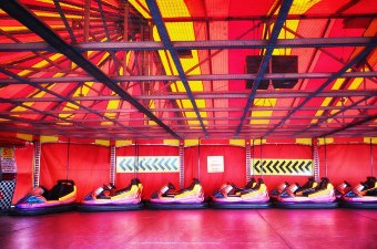 Image of bumper cars in a red and yellow track as one of the best attractions in NJ