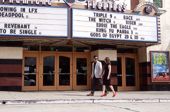 Image of a man and woman walking in front of a movie theater showing a fun thing to do in NJ
